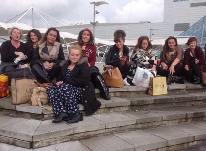 The team outside the Excel